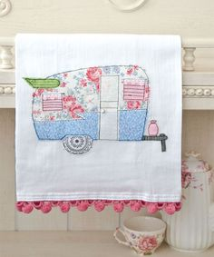 You're sure to be a happy camper with this article by Isabel Wagner for upcycling a tattered quilt into stylish, kitschy tea towels.   Sew Somerset