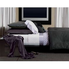 Love the dark gray and purple for bedding