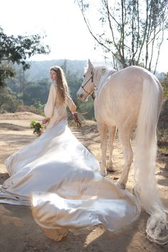 Love this with the horse. Flowing bridal gown {horse and bouquet are excellent accessories}