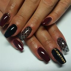 Black and maroon nail art design. The dark hues of the nail polish make a perfect combination when you want to channel an elegant and sophisticated look with having dark colors for your nails.