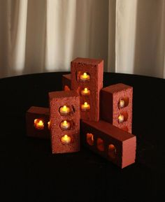 bricks with lights. for softer look- painted white bricks with floral accents