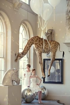 A styled shoot at the magical Aynhoe Park with balloons and giraffes.