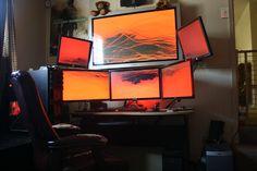 Monitor overload.... in the best kind of way. Plus red back light. Epic battlestation.