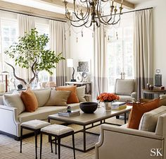 Likes chandelier, tree and furnishings.  Bobby says no to orange; Suzanne Kasler