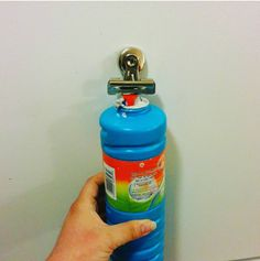 Attach a clip to the end of your kid's bubble wand to keep it from falling into the container.