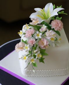 Many, many flowers on the tiny cake.