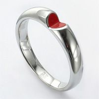 'heart ring 'by innopark, hong kong / china. two well-placed cuts cleverly transform the continuity of a sterling silver band  into a small inset heart shape, left either unfinished or plated in red.