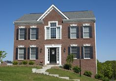 Brick exterior of the Augusta model home Add a porch and change the middle window upstairs.