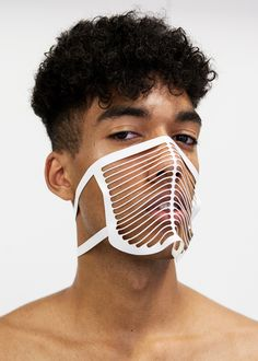 Rotterdam designer Martijn van Strien - mphvs - has launched his own fashion brand with a collection of unisex garments (made of heavy-duty PVC tarpaulin) that are laser cut into shapes based on architectural structures.