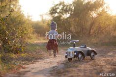 Toddler running during park stroll