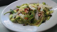 Zucchini Ribbon Salad with Pecorino Romano, Almonds and Honey by the splendidtable: This salad is pulled together by the piercingly sharp and salty flavor of southern Italy's Pecorino Romano. Here it plays against sweet, crunchy almonds, bits of black olive and a tiny drizzle of honey.  #Salad #Zucchini #Romano #Honey #Healthy