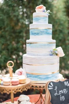 26 Beach Wedding Cakes That Will Wow Your Guests: Check Them Out! Four tiers of delicious seascapes! Wedding cake, blue watercolor paint, gold strip crowned by a Juliet garden rose. Beautiful Wedding Cakes, Beautiful Cakes, Dream Wedding, Perfect Wedding, Country Wedding Cakes, Beach Wedding Cakes, Beach Cakes, Wedding Table, Beach Weddings