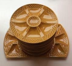 okrankeltainen osterilautassarja 1920-50 luvulta, 9 lautasta