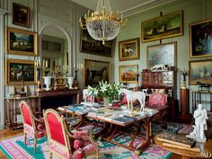On one side of the double salon in Château de Digoine, mahogany tables used by…
