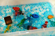 Ocean themed sensory Bin with marine Safari tube and water beads