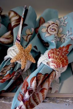 Turks head knot napkins rings with sea shells. Perfect for beach themed weddings or bridal showers! #celebstylewed