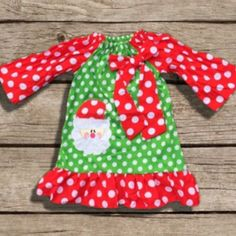 """Girl's red & green polka dot Christmas dress with Santa applique. Add Accessories Just choose """"With Accessories"""" when choosing size. Cotton/Spandex True To Size Order the size she normally wears every"""