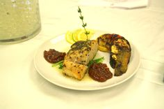 an Seared Corvina with a fig/mango/dates chutney and roasted vegetables brushed pesto