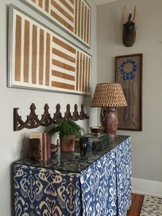 Console table in entry way. Design by Meredith Ellis. Image by Amy Bartlam. See more at www.StyleBlueprint.com.