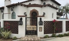 Custom hand forged iron exterior lanterns created by www.haciendalights.com for clients Santa Barbara style residence.