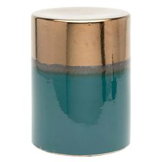 Each cylindrical Trixie will have an individual look, thanks to the reactive glaze technique of its finish. Bubbles, drips, and artful imperfections create the stool's charm, especially where the top crackled gold glaze meets either the bottom blue celadon or the dusty blue to reveal three stunning rings of color. Outdoor approved, not suitable for freezing temperatures.   Finish: Crackled Gold/Dusty Blue Ceramic (Shown), Crackled Gold/Blue Celadon Ceramic
