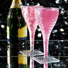 Toast to a sweet new start! Dunk cotton candy in champagne to create an extra-special sipper - yum! Click for more New Years Eve party ideas.