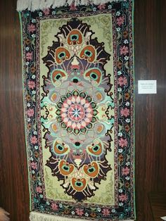 Woolin Rouge Review Hooked by Brother Lluellyn Kouba at Assumption Abbey, Richardton, ND. Prairie Rose Rug School.
