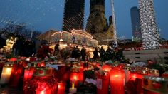 Candles and flowers laid as a tribute at the Breitscheidplatz market in Berlin on 22 December 2016