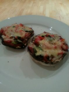Carb-less snacky pizzas... thanks to Liz Lim for the idea! Pizza ingredients in a flat mushroom and grilled... I used no added salt tomato paste, avocado, fresh basil, himalayan salt, capsicum, onion and lactose free cheese.... yummy!