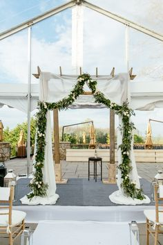 Romantic Eucalyptus Garland-Accented Wedding Ceremony Arbor | Photo: Tory Williams Photography |