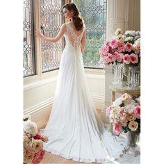 Krásné svatební šaty zdobené krajkou