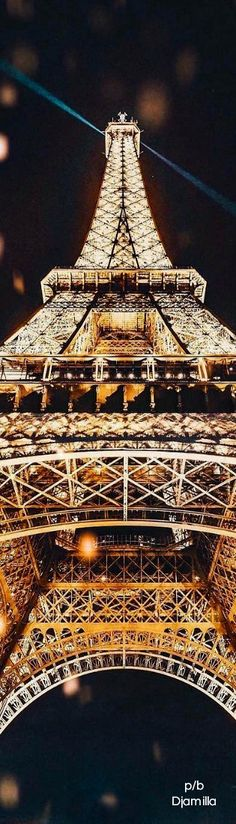 The Eiffel Tower at night, Paris France