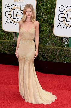 Rosie Huntington in gold strap dress with tulle train // Golden Globes 2016 Red Carpet Favorites
