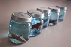 Ocean Snow Globes: Baby Food Jars, plastic fish, water, glycerin, and glitter.