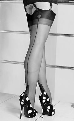 Adorable boudoir shot highlighting legs - great for a cute pair of tights you have, especially the polka dot shoes!