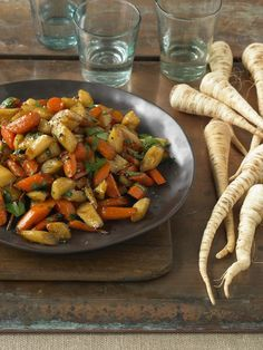 Skillet Roasted Parsnips and Carrots | Earthbound Farm Cookbook / made this.. nice twist on roasted carrot dish