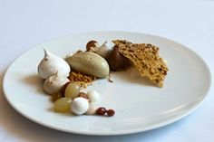 Deconstructed vacherin : hazelnuts and pistachios, with chestnut and chocolate gelato, the plate dotted with grapes, raisins, and miniature meringues.