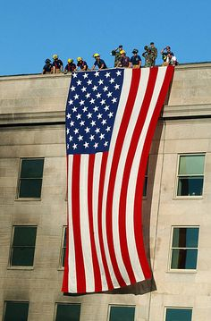 This is the flag that was hung over the side of the Pentagon in Arlington, Virginia after the September 11, 2001 terrorist attacks which included a jet airliner with passengers crashing into the side of the building. It is now on display at the Smithsonian's American History Museum.