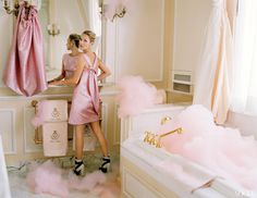 At First Blush - Moss, in the bathroom of the Coco Chanel Suite, wears a petal-like cocktail dress and cape, inspired by a 1960 design, from a pink-and-silver cloque lamé created by Cristóbal Balenciaga. Balenciaga by Nicolas Ghesquière dress and cape, made for Vogue, and ankle boots. Boucheron bracelet.