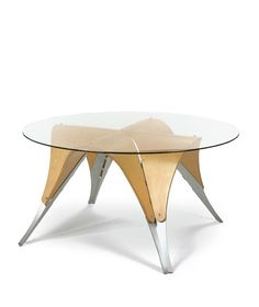 Ali Tayar ''MICHAEL'S TABLE'' laminated birch plywood, folded aluminum, and glass 29 1/2 in. (74.9 cm) high 60 in. (152.4 cm) diameter 1991