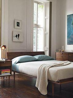 simple wood platform bed, high ceiling