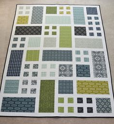 Taking Turns. I'd love to make this in fabrics to match the colors for the living room. No pattern, but looks pretty basic.