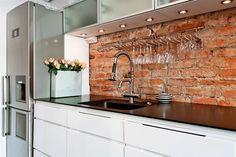 Under cabinet lighting to brighten exposed brick kitchen