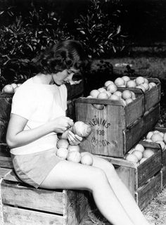 c. 1949. Betty Evans with crated #oranges in a grove near the Indian River. #IndianRiver #Florida