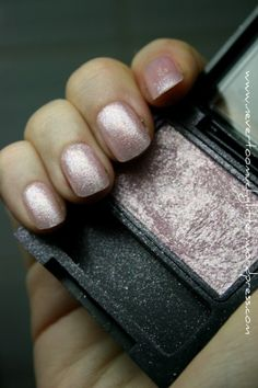 Make your own glitter polish using clear polish and eye shadow.