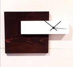 This modern wall clock will add a clean, unique touch to your home decor. This beautiful clock has a touch of modern chic flair that will quickly become a focal point in your space. Order now! This clock can be made in larger sizes and any color combination that you would like.