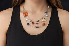 Wear All the Planets in the Solar System (And Pluto) Around Your Neck | Mental Floss
