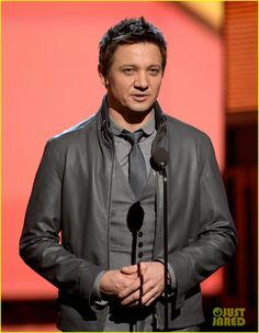 Jeremy Renner takes the stage at the 2014 Grammy Awards held at the Staples Center on Sunday (January 26) in Los Angeles.