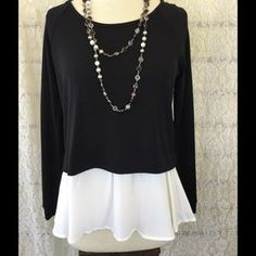I just discovered this while shopping on Poshmark: BLACK LAYERED BLOUSE. Check…
