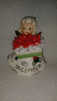 Vintage Lefton Birthday Angel - December. Measures approx. 4-1/4 tall. Stamped on bottom is: Poinsettia, Blue Zircon 489.